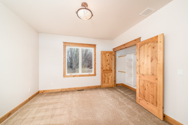 Bedroom with built in closet storage and