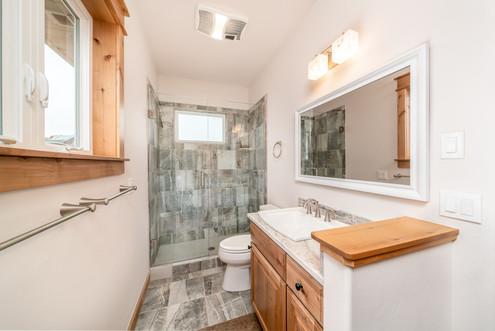 Guest bath featuring tiled, glass shower