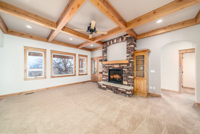 Living room featuring fireplace, built i