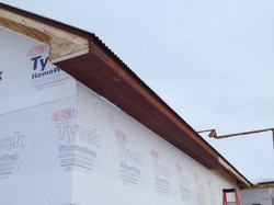 Rusty metal soffit and fascia