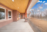 Custom home back deck featuring stucco,