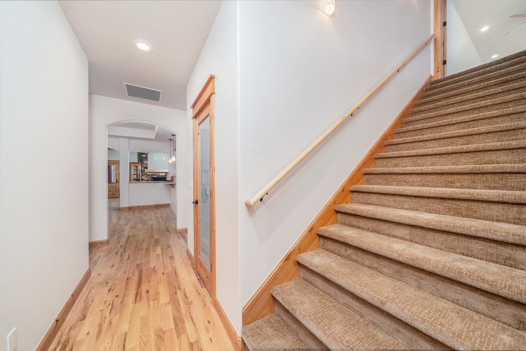 Stairway leading to bonus room and hallw