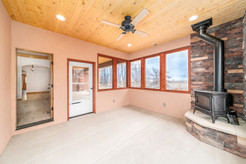 Screened in porch with wood burning fire