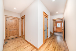 Hallway leading to guest half bath, larg