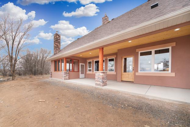 Custom home exterior with stucco, rock m