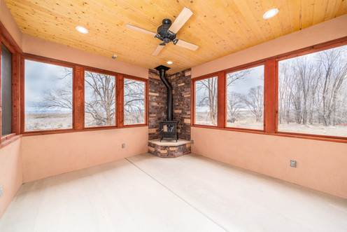 Screened in porch with wood buring firep