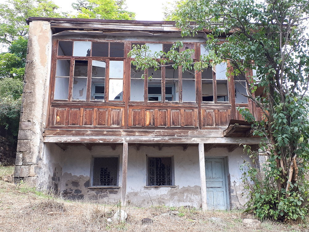 This traditional house with living quarters on the top floor and barn on the bottom looks recently abandoned.