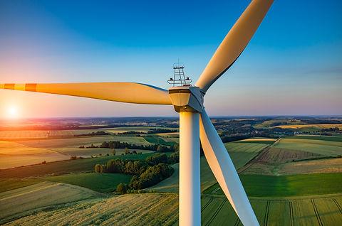 Beautiful sunset above the windmills on