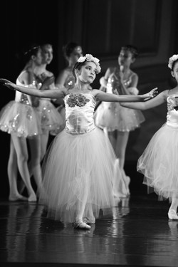 """Black and white group photo of ISB dancers on stage performing a piece from """"Sleeping Beauty"""""""