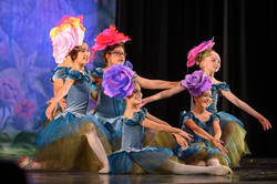 """Inspire School of Ballet dancers dressed as flowers performing a group piece for ISB's """"Alice in Won"""