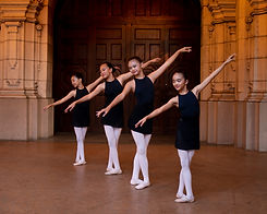 Four ISB ballet dancers lined up in front of door at Balboa Park in San Diego, CA.