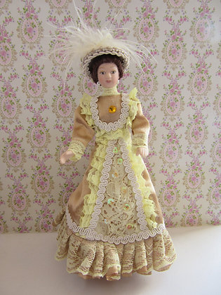 ELEGANT DOLL IN GOLD AND CREAM
