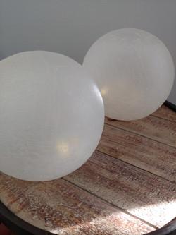 2 glowing glass globes