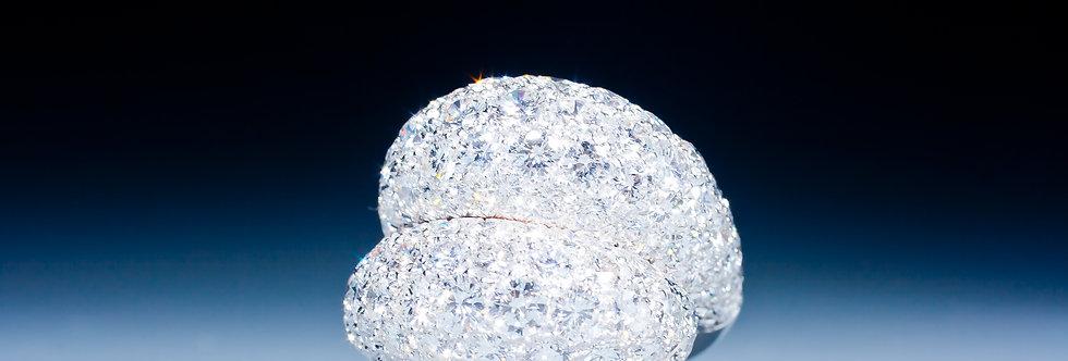 An elegant diamond crossover ring by Van Cleef & Arpels