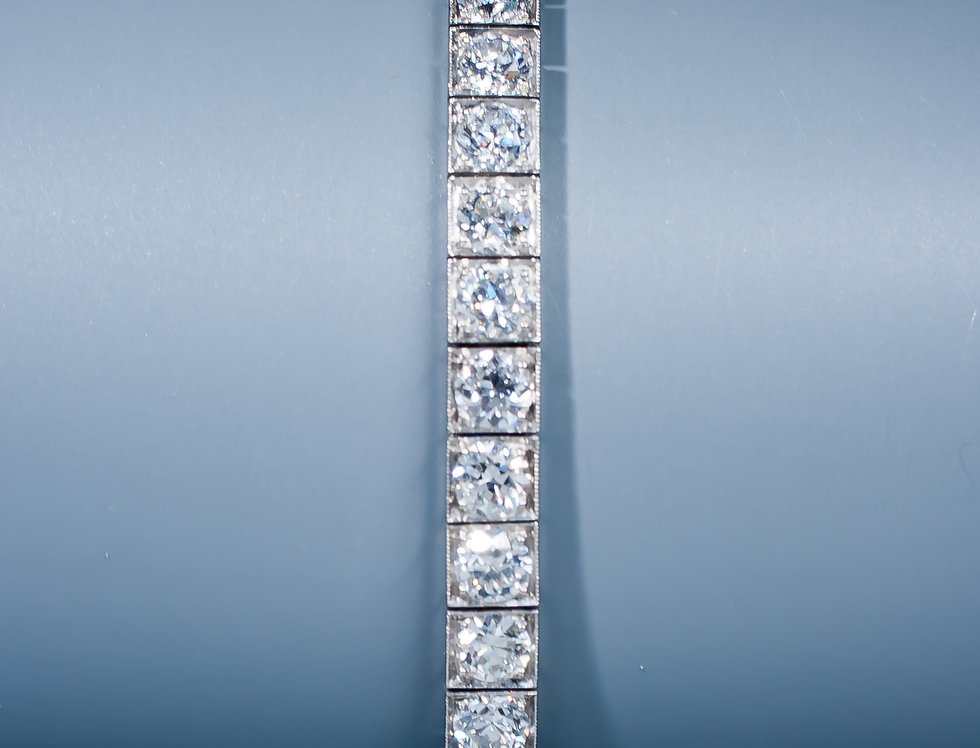An Art Deco platinum and diamond line bracelet by Tiffany & Co