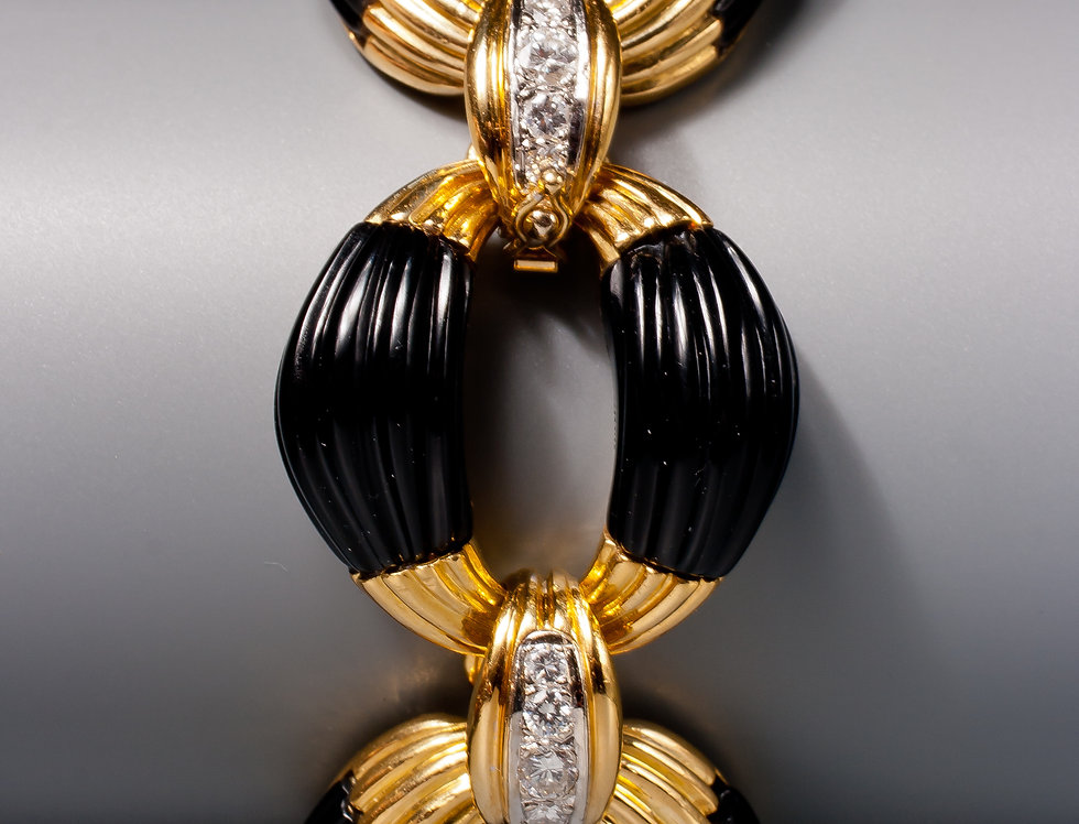 A very stylish onyx and diamond bracelet, retailed by Neiman Marcus