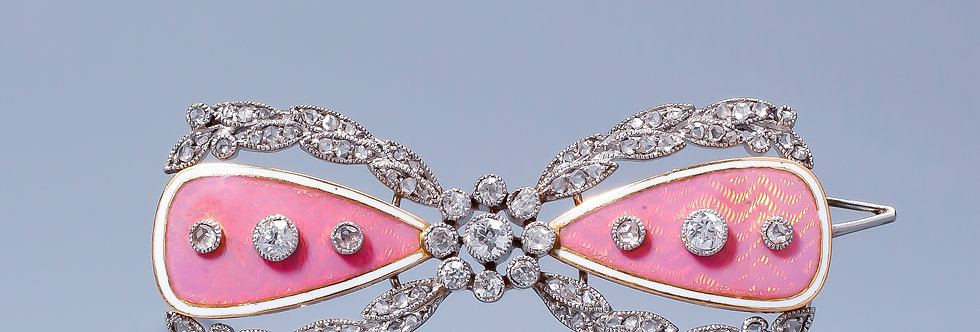A Garland Style diamond and enamel bow brooch by Cartier