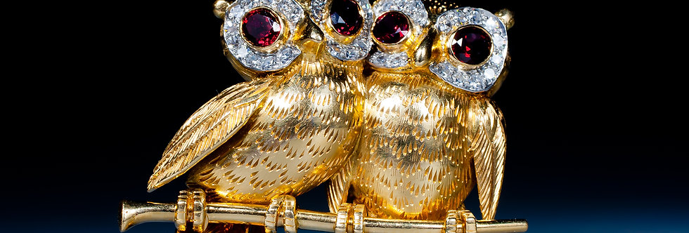 A very charming owl brooch by Cartier