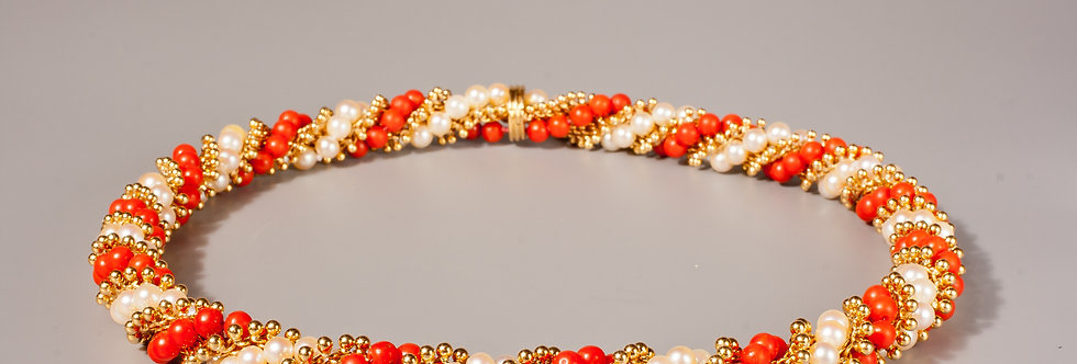 An 18 karat gold, pearl and coral torsade necklace by Van Cleef & Arpels