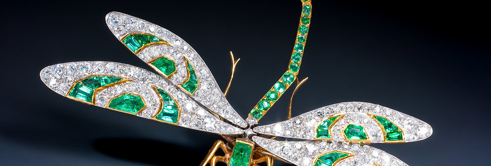 An Art Nouveau ruby, emerald and diamond dragonfly brooch by Georges Fouquet