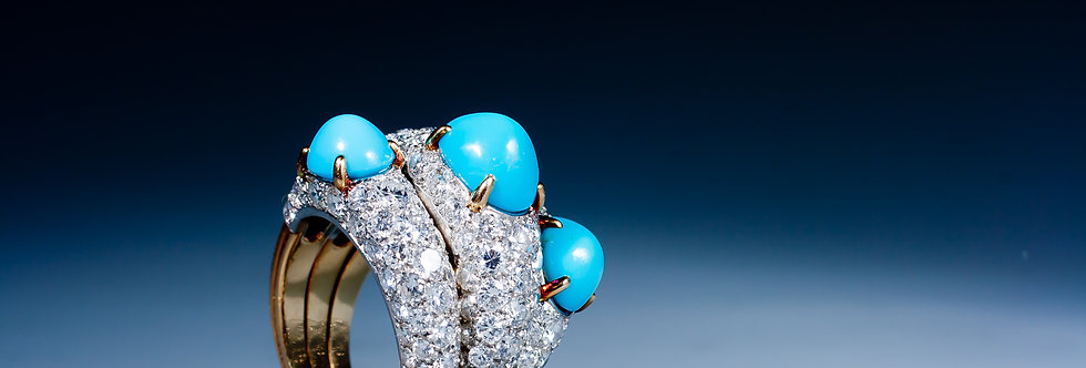 An unusual turquoise and diamond cocktail ring by Cartier