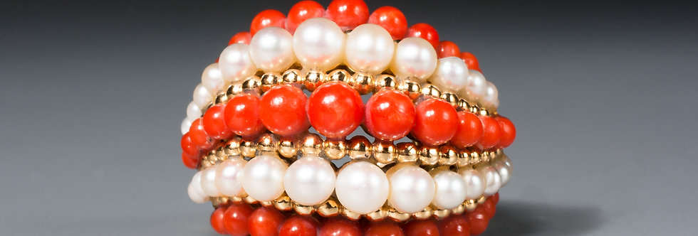 An 18 karat gold, pearl and coral bombé ring by Van Cleef & Arpels