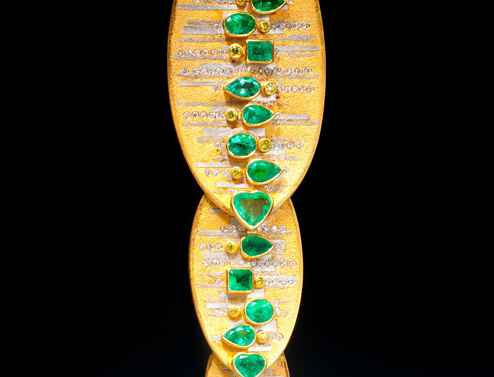 A one of a kind emerald and diamond pendant/brooch by Michael Zobel