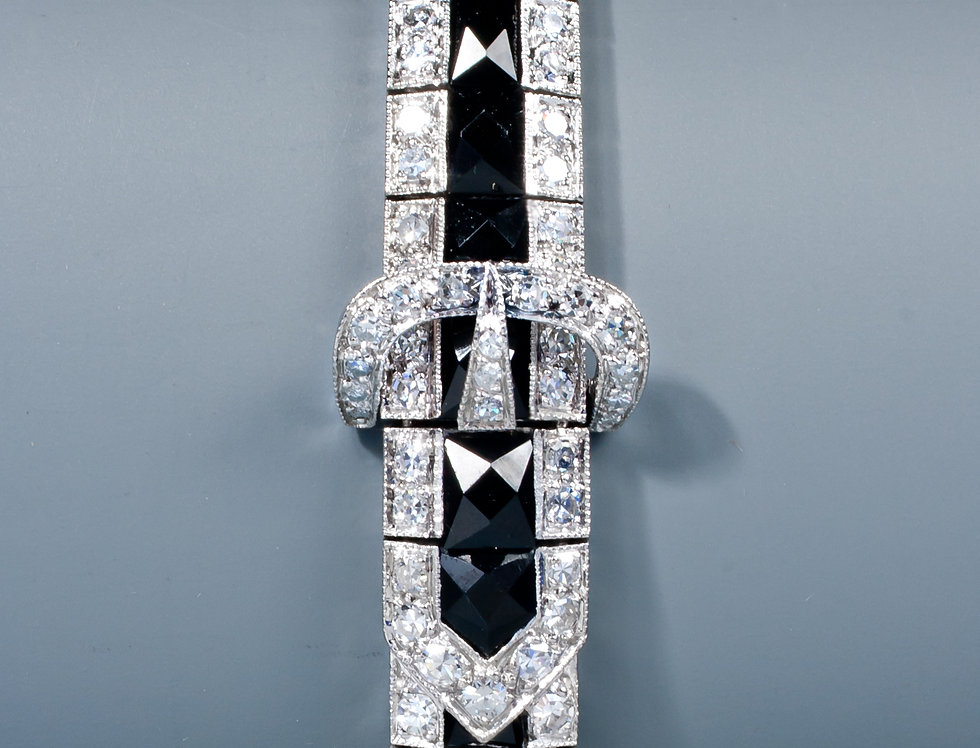 A very elegant early Art Deco onyx and diamond bracelet