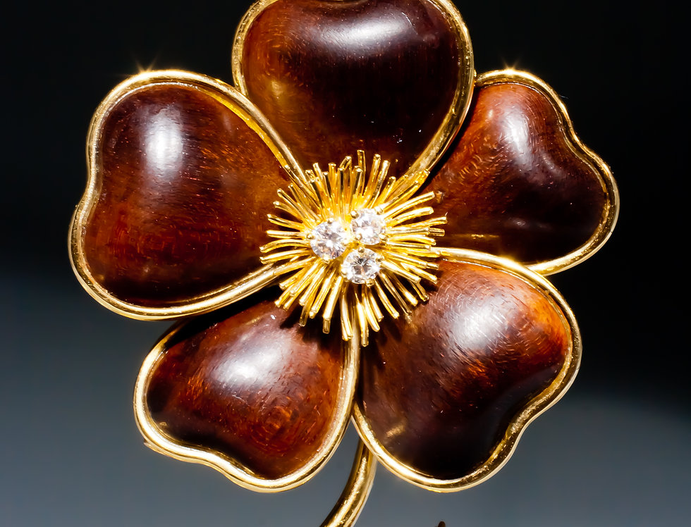 An 18 karat gold and wood 'clematite' flower brooch by Van Cleef & Arpels, Paris