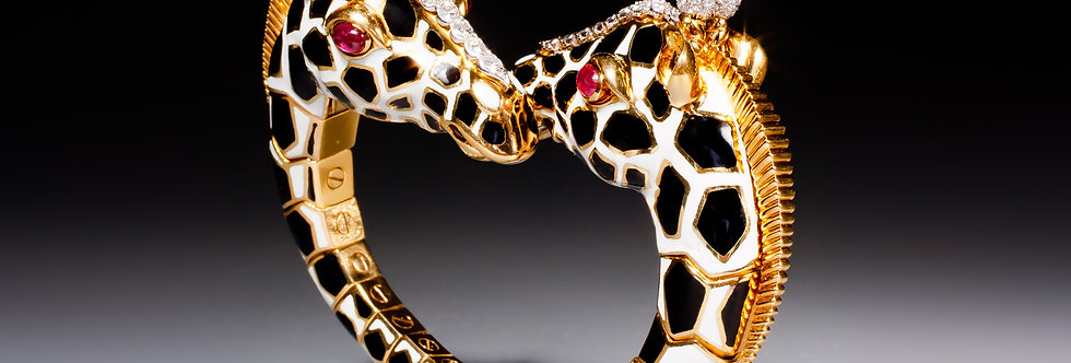 A magnificent twin giraffe bracelet of crossover design by David Webb
