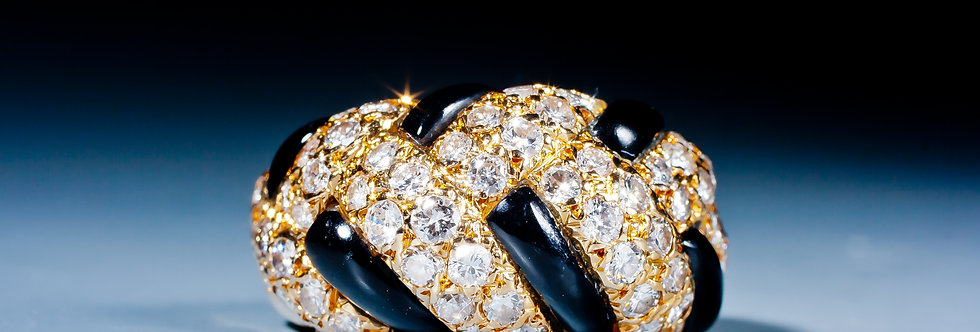 An onyx and diamond ring by Van Cleef & Arpels