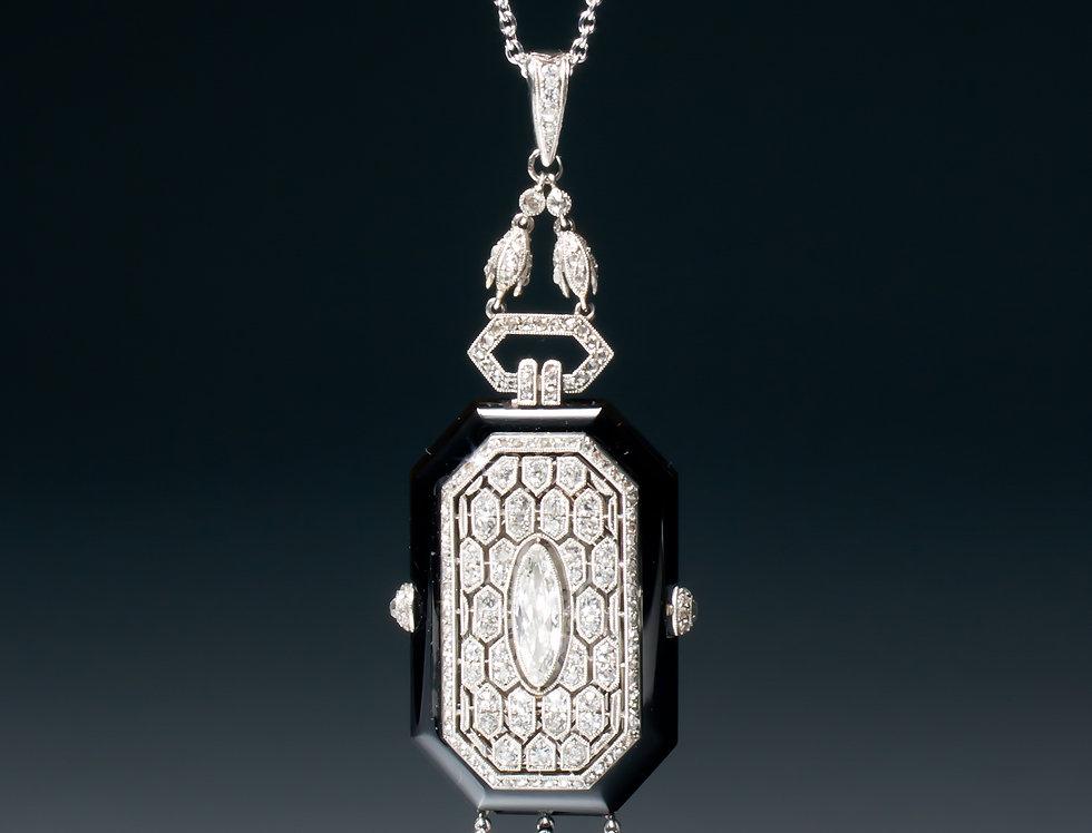A very rare Art Deco onyx and diamond pendant watch by Boucheron