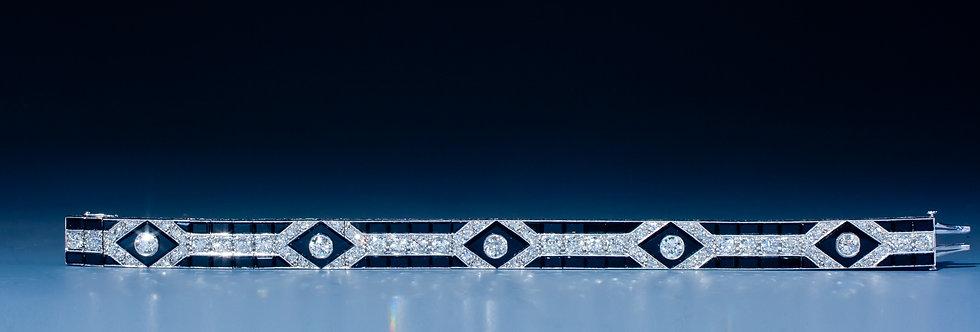 A very fine onyx and diamond bracelet by Mauboussin, Paris