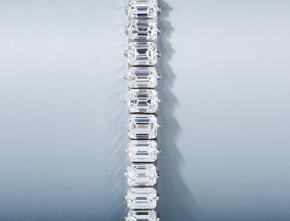 A very fine emerald cut diamond line bracelet,