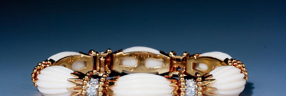 A very fine coral and diamond bracelet by Van Cleef & Arpels