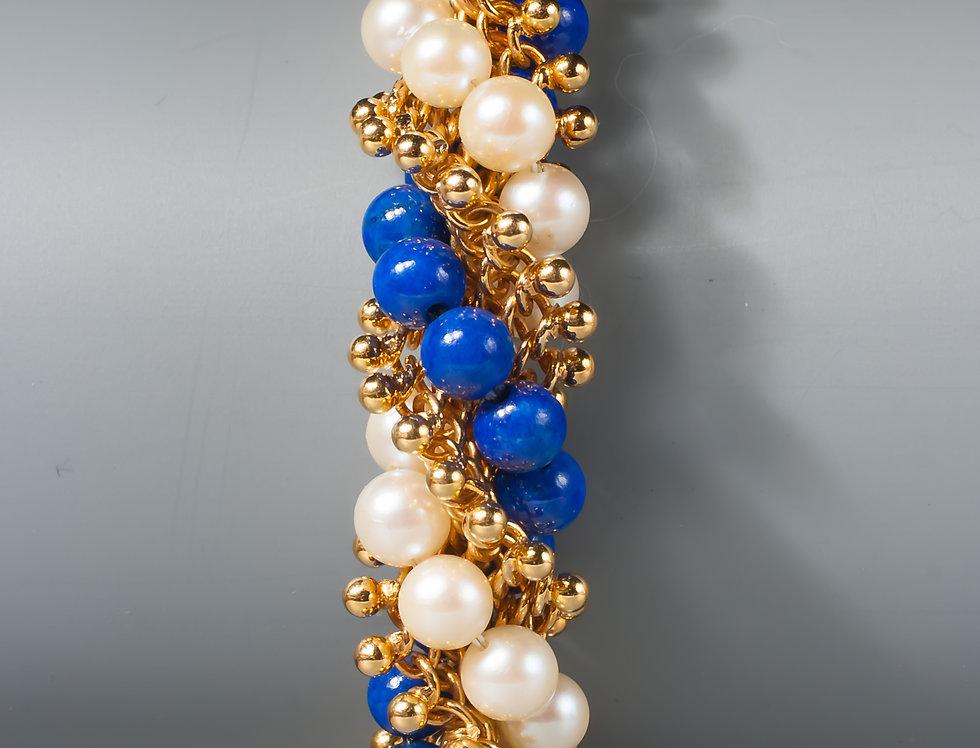 An 18 karat gold, pearl and lapis torsade bracelet by Van Cleef & Arpels