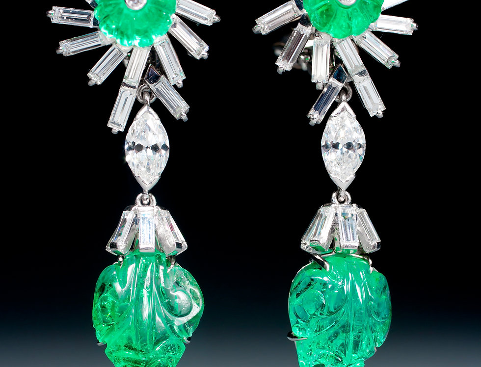 An unusual pair of carved emerald and diamond earrings by David Webb
