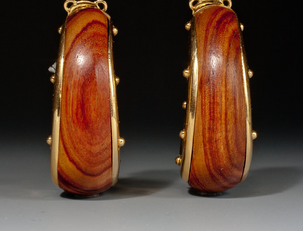 A fine pair of noble wood and 18 karat gold earrings by François Herail