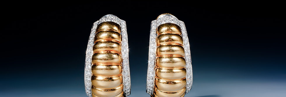 A fine pair of 18 karat gold and diamond earrings by David Webb
