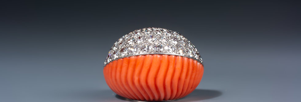 A magnificent coral and diamond ring by Cartier