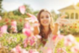 woman throwing rose petals.jpg