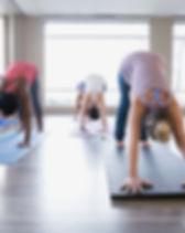 Clase de Yoga - perro boca abajo