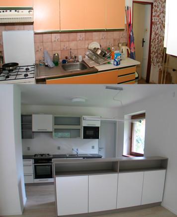 Kuchyňská linka s ostrůvkem v bílém lesku v kombinaci šedého betonu.