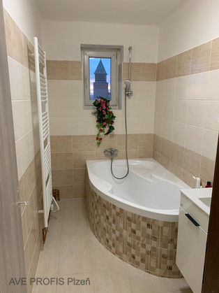 Rekonstrukce koupelny v rodinném domě. Obklad Rako Lazio.