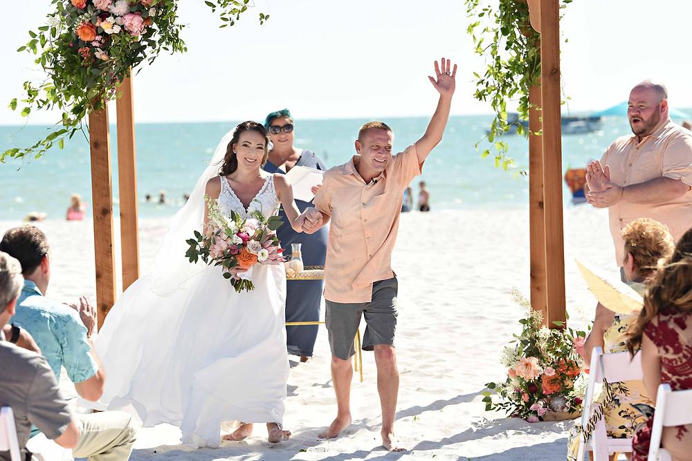 Beach wedding ceremony said I do