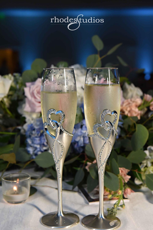 Reception wedding details, champagne flutes, in the Grand Ballroom at Orlando Omni Championsgate, Orlando wedding photography