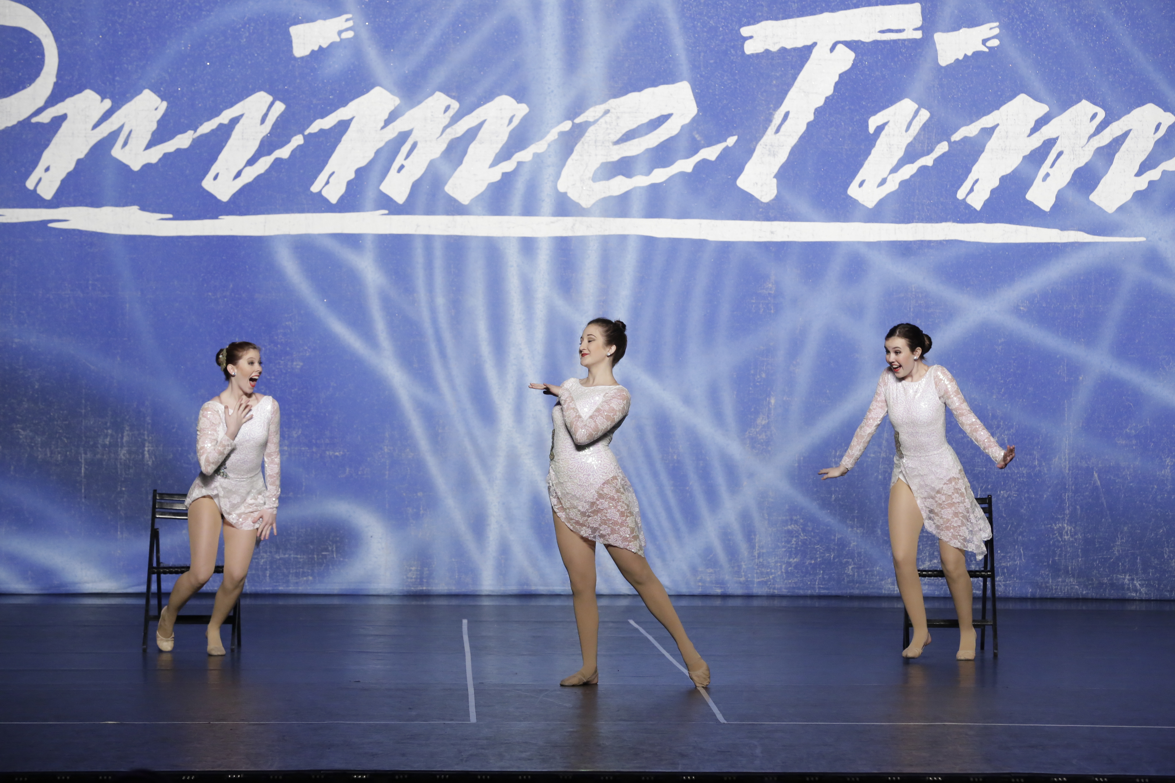 Competitive dancers emoting in white