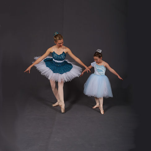 Two ballet students in tutus posing