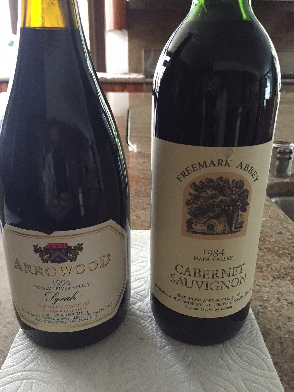 Two bottles of wine that have spoiled