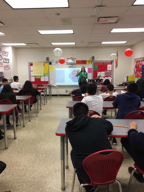 Jennifer speaking to 8th graders for Career Day 2019